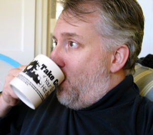 Andy drinking out of his new Take Control Mug